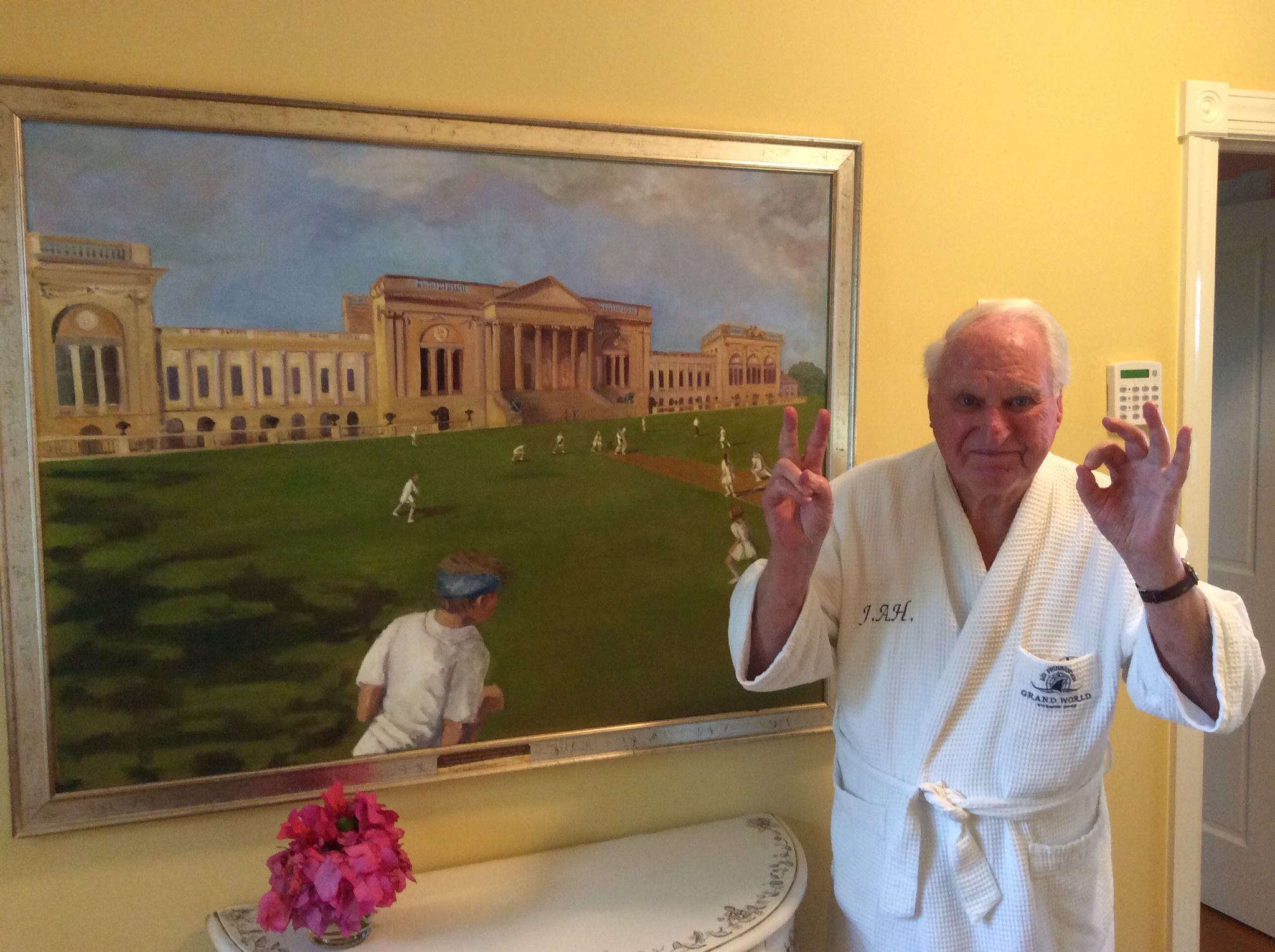 sir-jack-hayward-with-painting-comissioned-to-debs-last-framed-by-frame-art-display